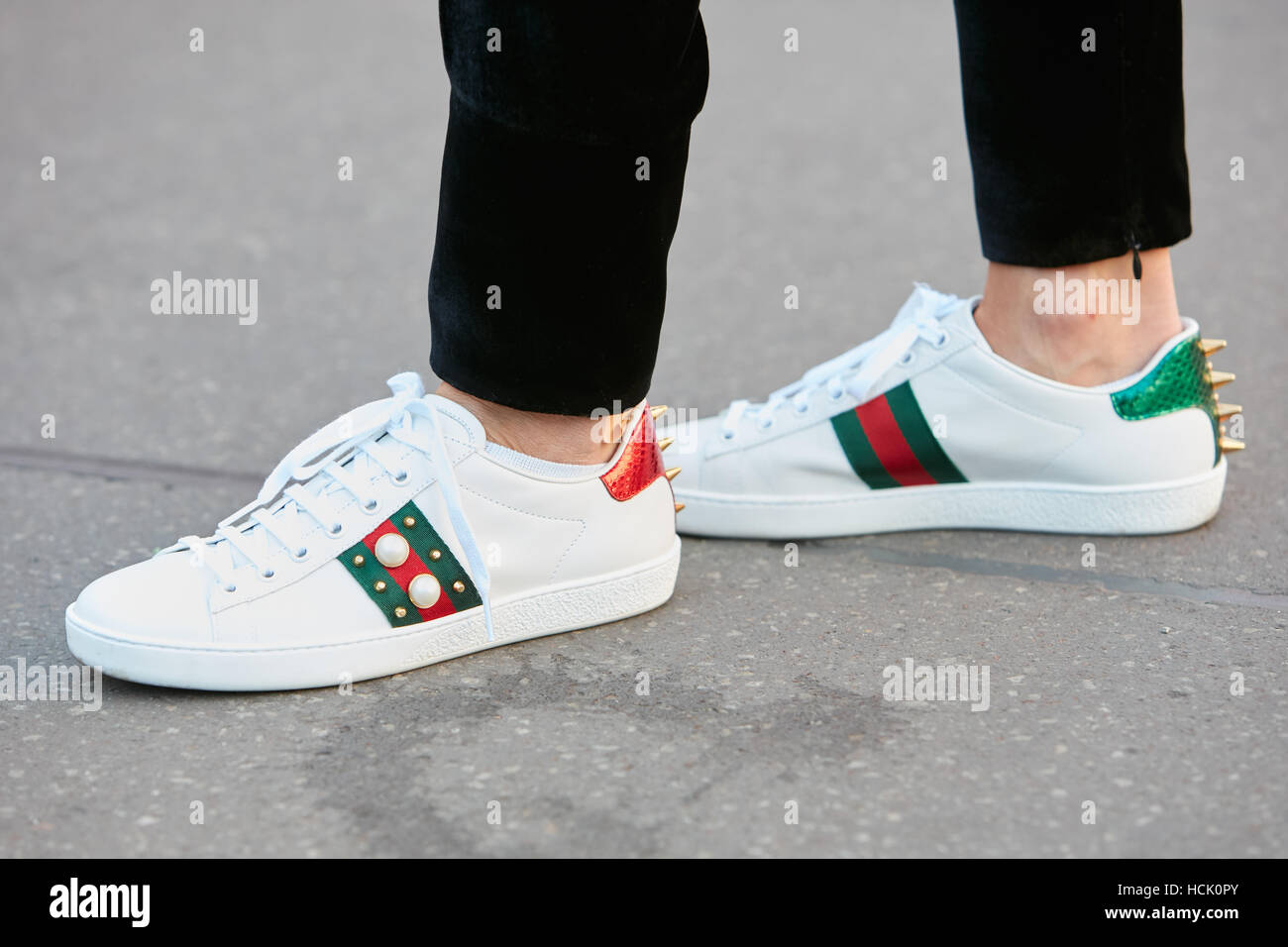 84e48ea890c5 Woman with white Gucci sneakers before Jil Sander fashion show ...