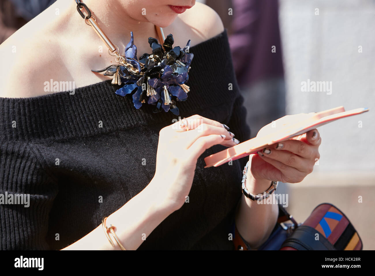 Woman with floral jewel necklace before Stella Jean fashion show, Milan Fashion Week street style on September 25, Stock Photo