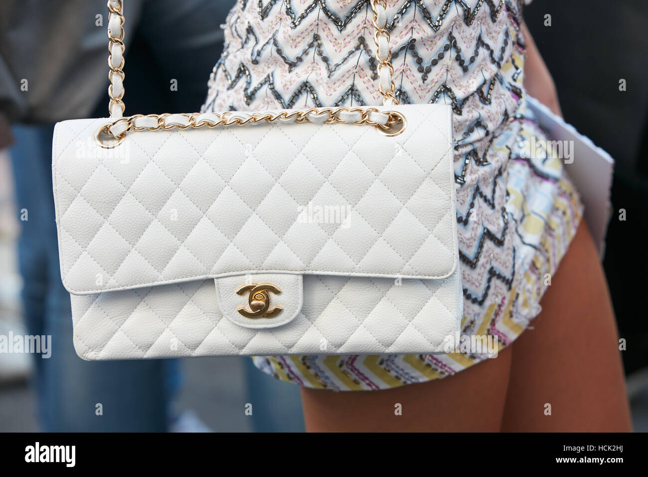 Woman with white leather Chanel bag before Salvatore Ferragamo fashion  show d75be115aa3a