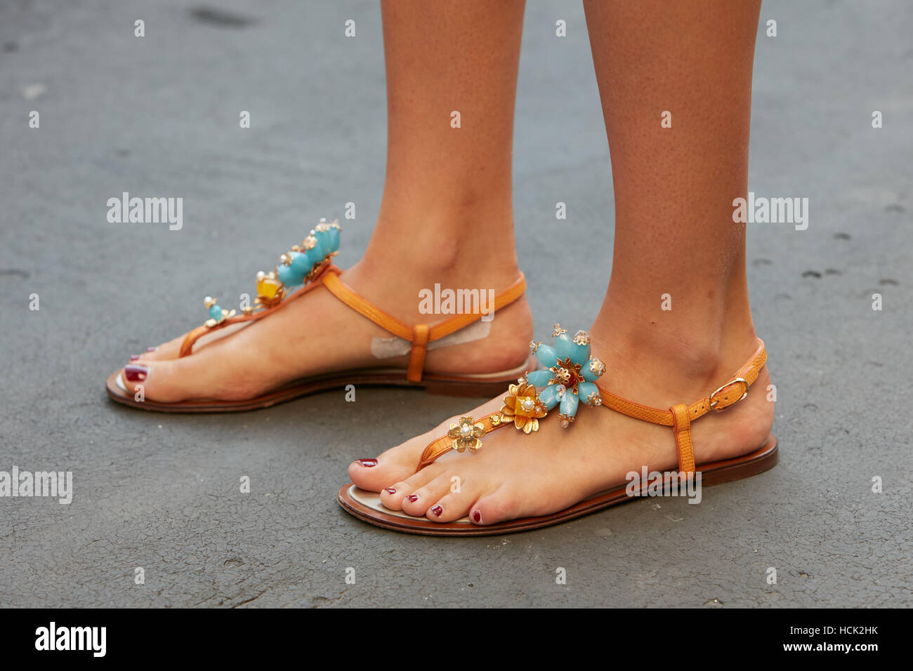 Woman with sandals with flower jewels decoration before Salvatore Ferragamo fashion show, Milan Fashion Week street - Stock Image