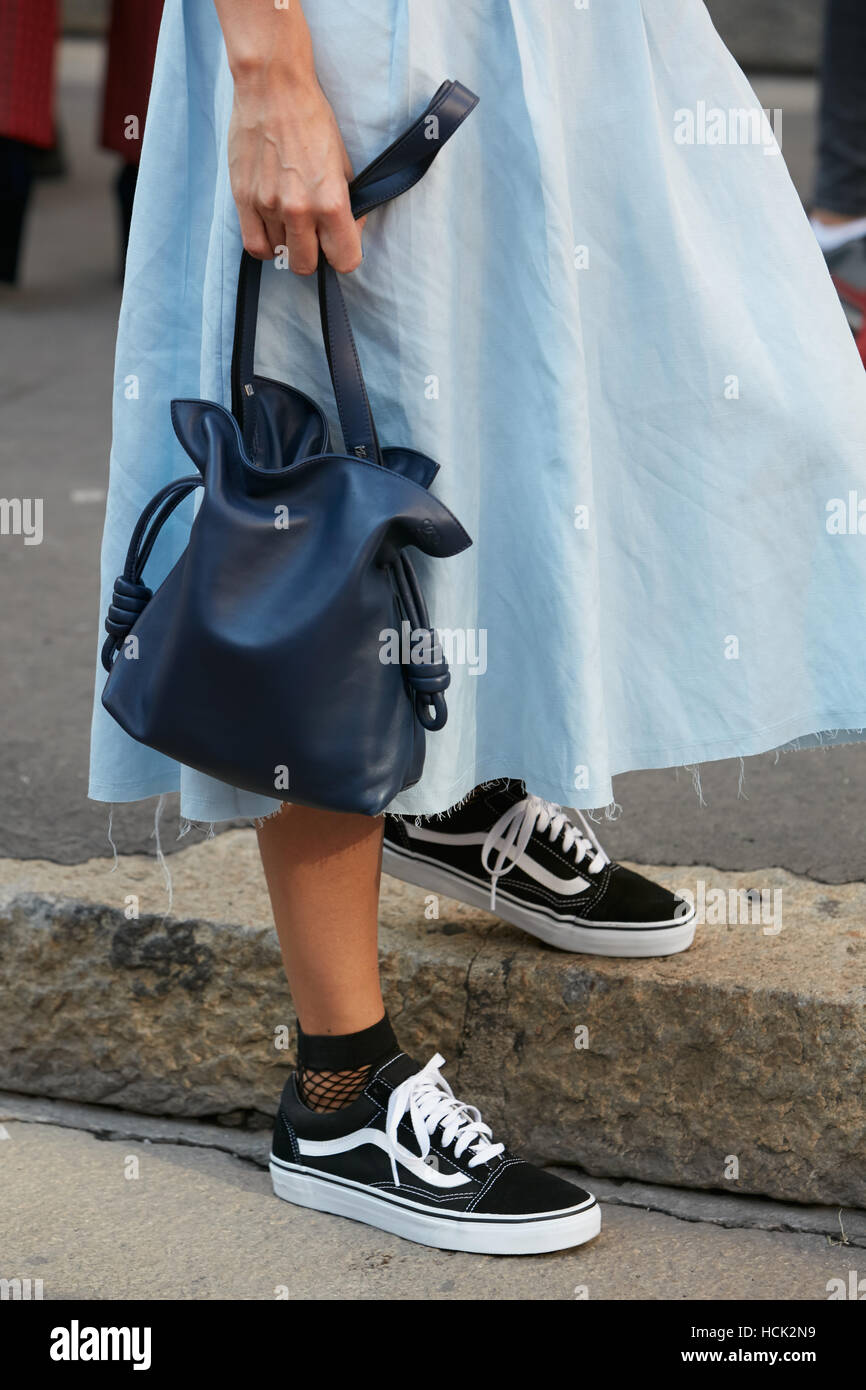 6c2fdd6e7b Woman with blue leather Loewe bag and Vans shoes before Salvatore Ferragamo  fashion show