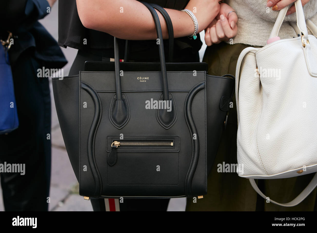 a62df55a17fa Woman with black Celine leather bag before Salvatore Ferragamo fashion  show