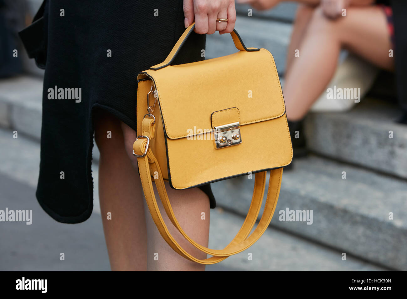 968995cd36 Woman with yellow leather bag before Salvatore Ferragamo fashion show
