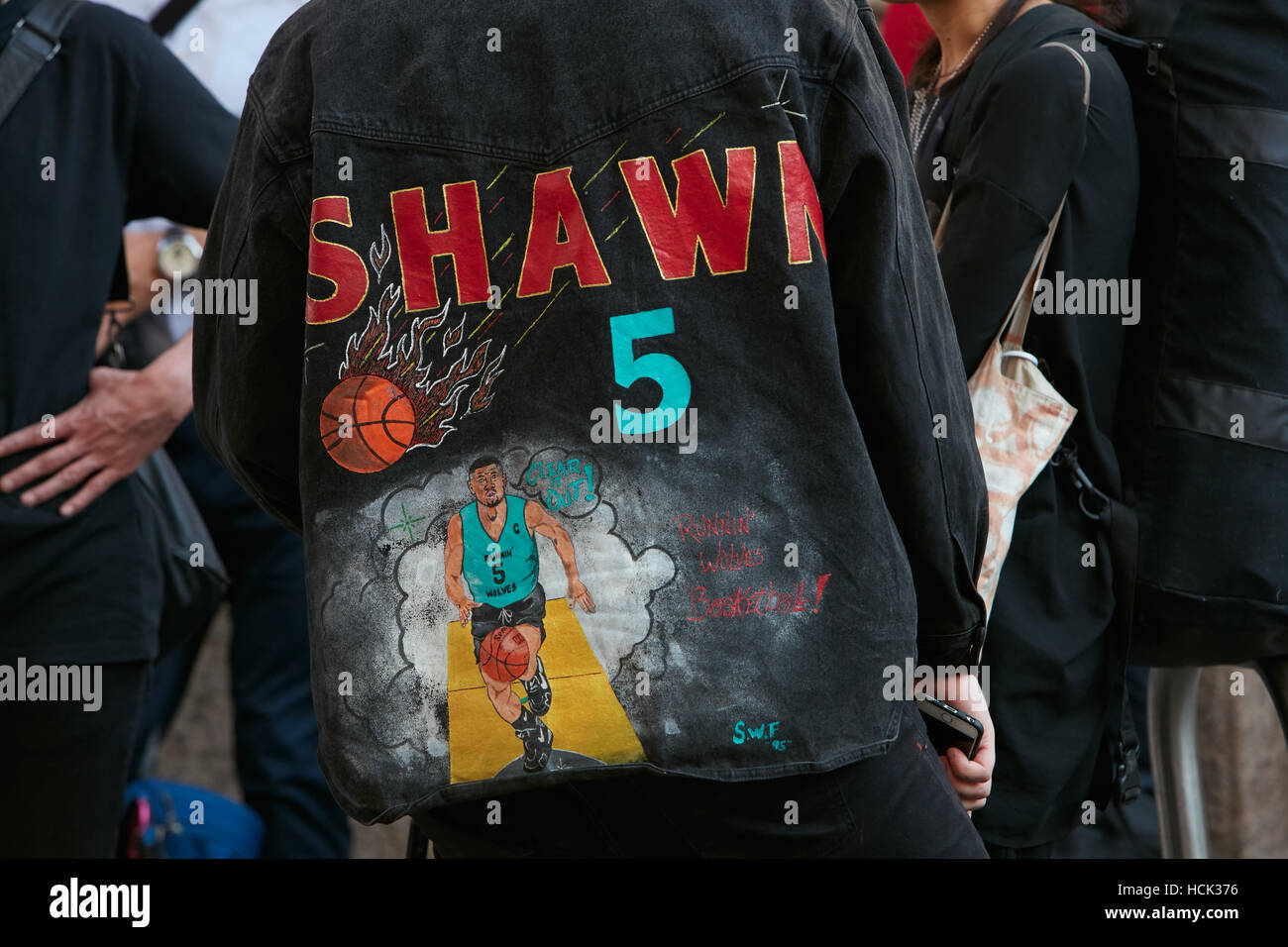 Man with black jacket with basket ball player before Salvatore Ferragamo fashion show, Milan Fashion Week street Stock Photo