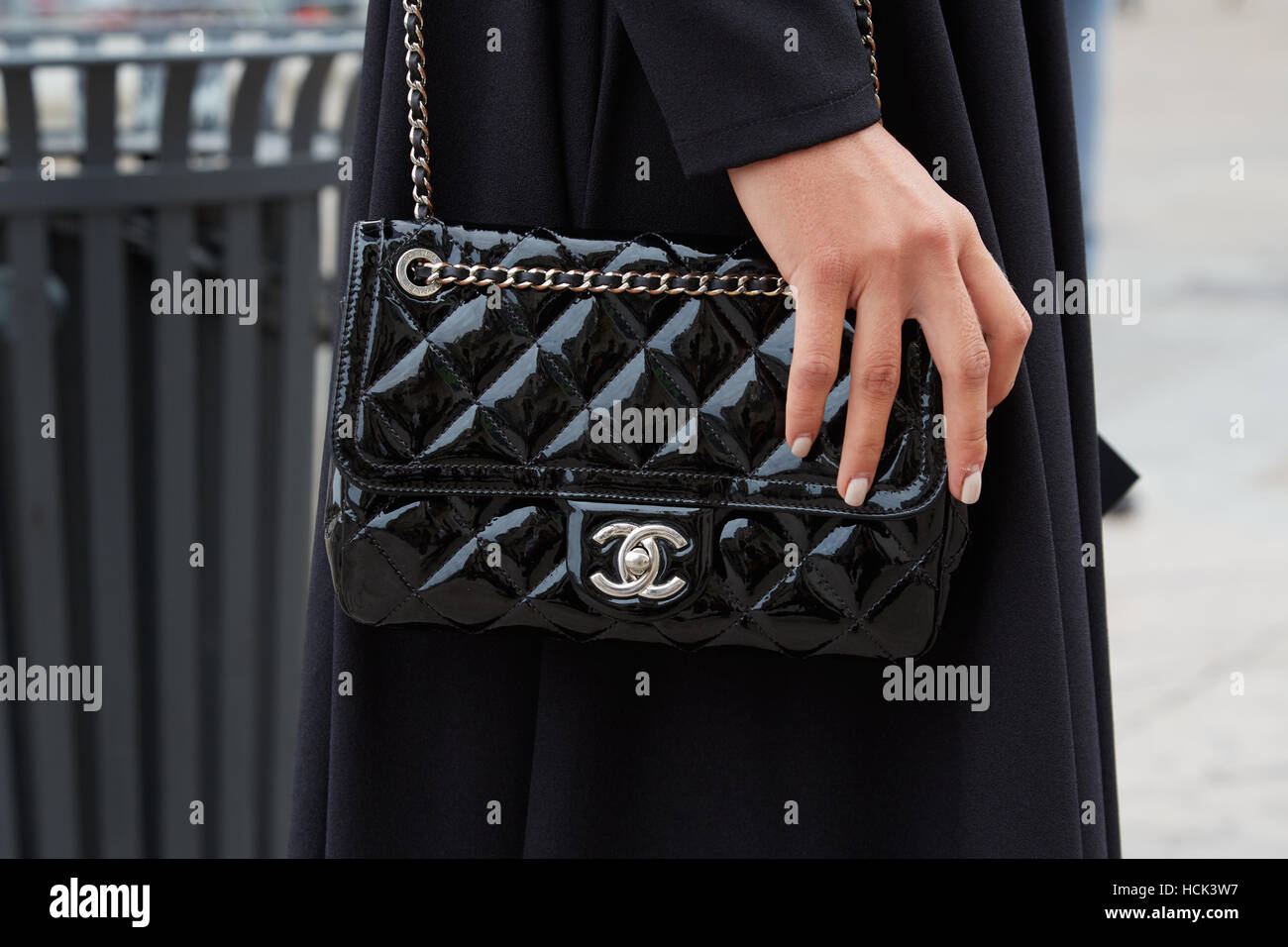 12699e463396 Woman with black Chanel patent leather bag before Genny fashion show, Milan  Fashion Week street