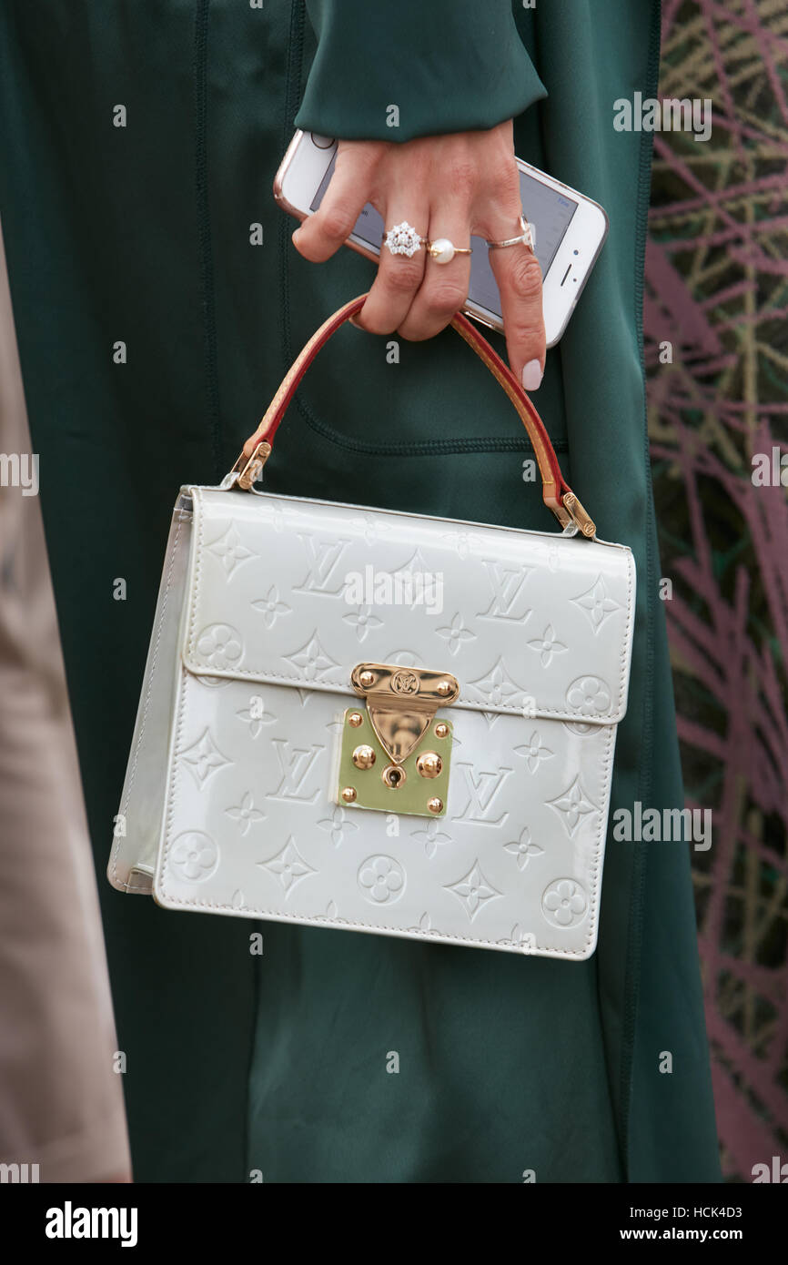Woman with white Louis Vuitton square bag before Gucci fashion show, Milan  Fashion Week street style on September 21, in Milan. 49e43473f82