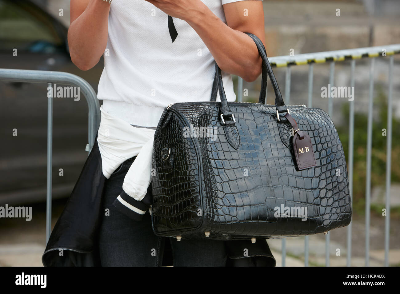 df39d11f961 Woman with Louis Vuitton black crocodile leather bag before Gucci fashion  show