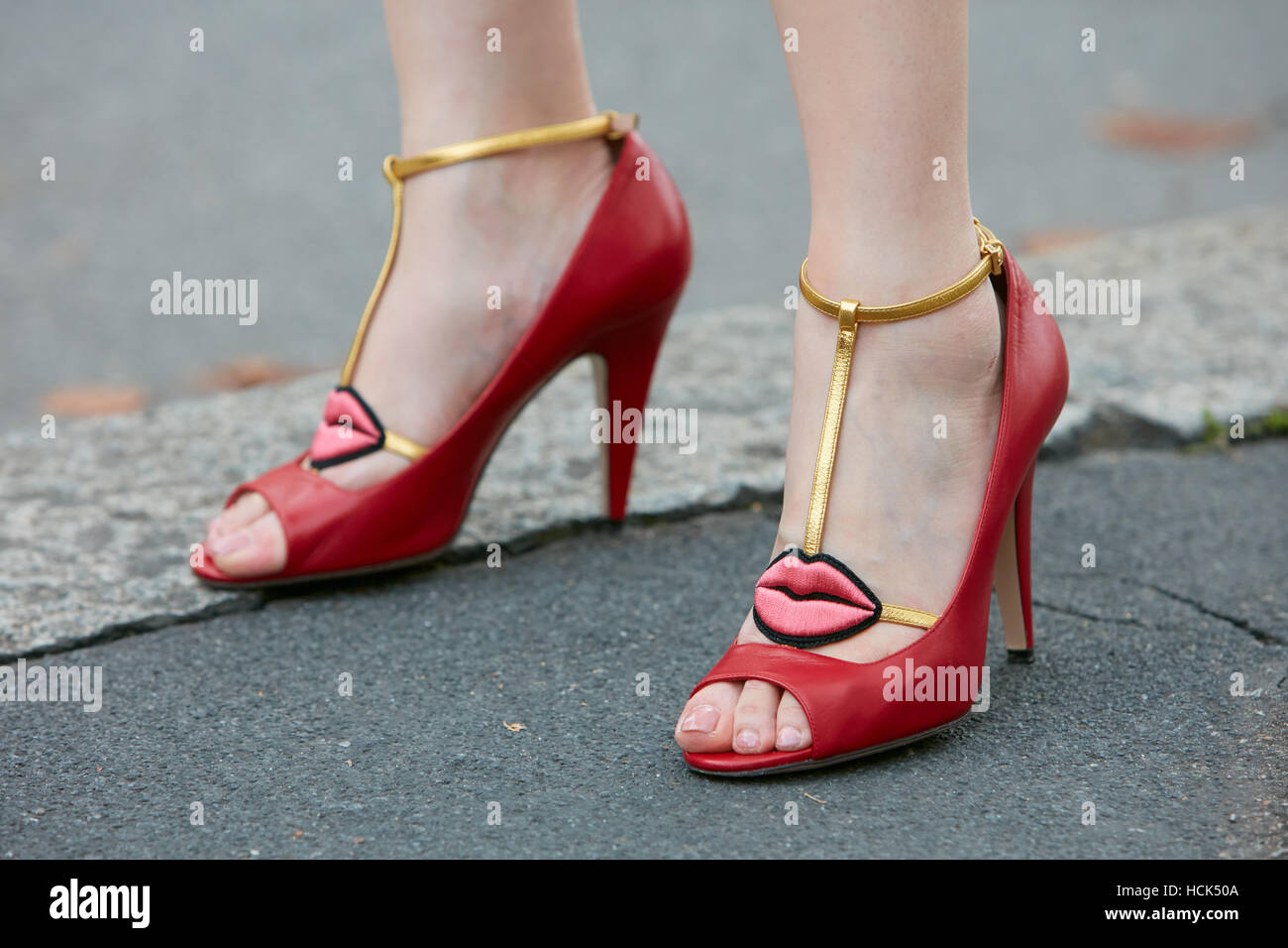b3cae9aa80d Woman with red high heel shoes with lips shape before Wunderkind fashion  show