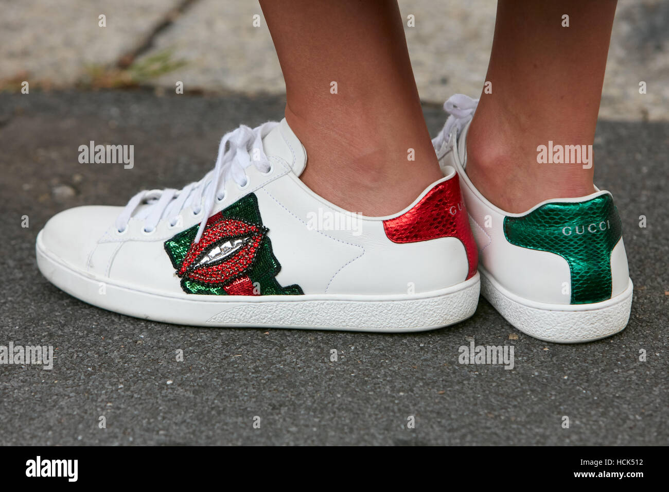 2d7889c2673 Woman with Gucci white sneakers with red mouth before Gucci fashion show