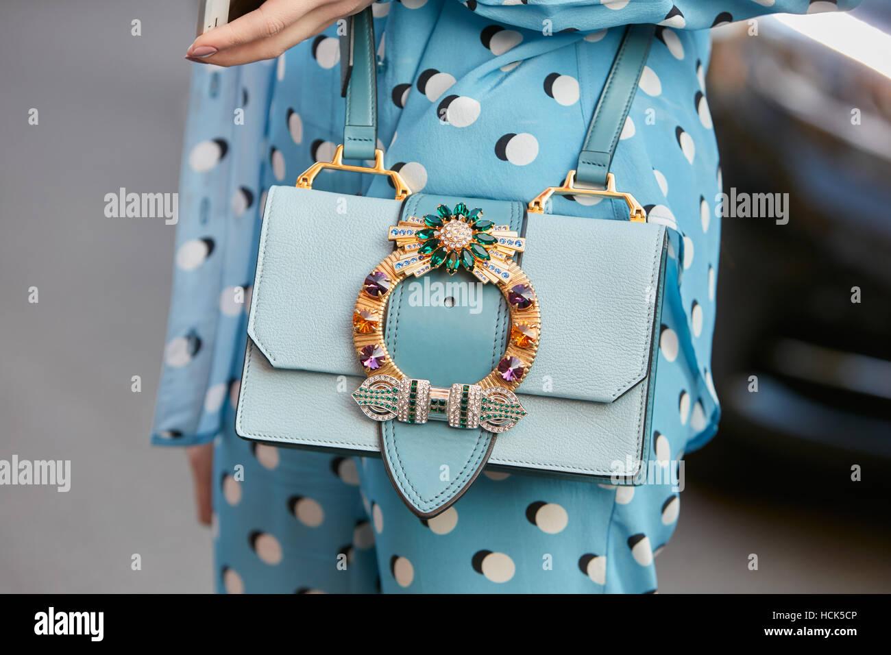 Woman with pale blue jewel bag before Prada fashion show, Milan Fashion Week street style on September 22, 2016 - Stock Image