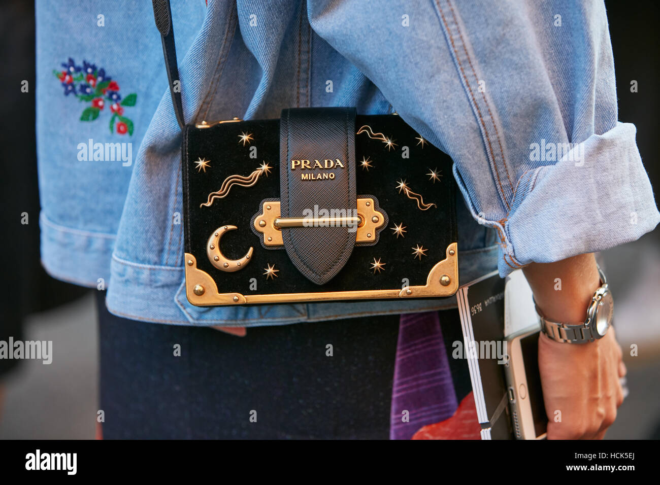 c2ec932999b867 Woman with Prada bag with moon and stars before Prada fashion show, Milan  Fashion Week street style on September 22, 2016