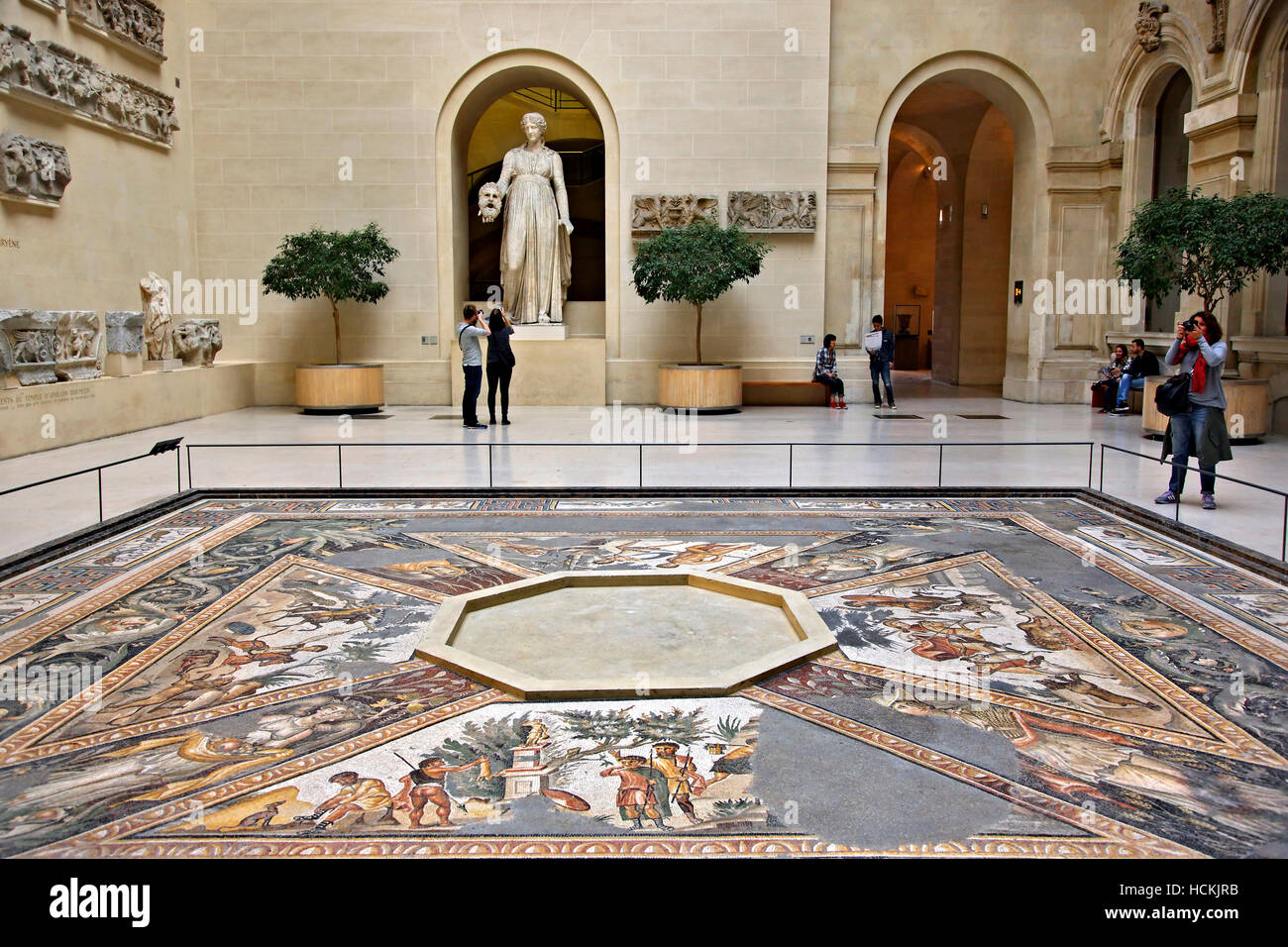 The Sphinx courtyard, with the 'Seasons' mosaic floor and a statue of Melpomene, Denon wing, Louvre museum, - Stock Image