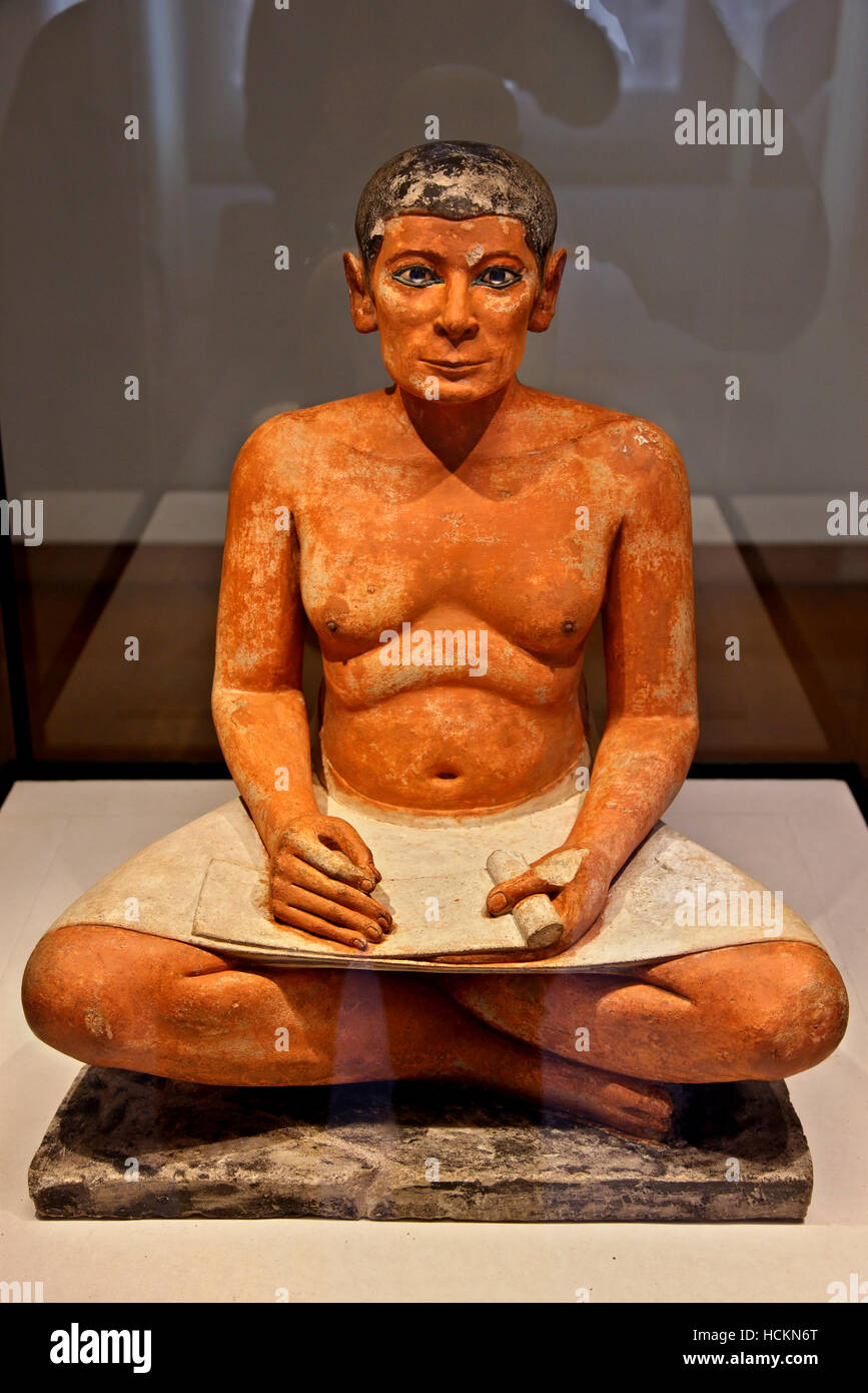 The sculpture of the Seated Scribe or Squatting Scribe,  a famous work of ancient Egyptian art,  Louvre Museum, - Stock Image