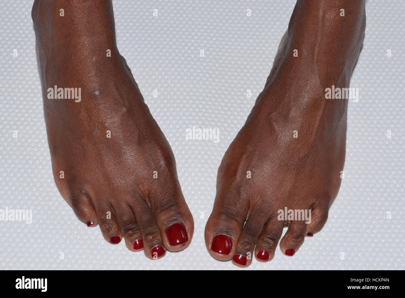 Two female feet turned inwards on a white surface Stock Photo ...