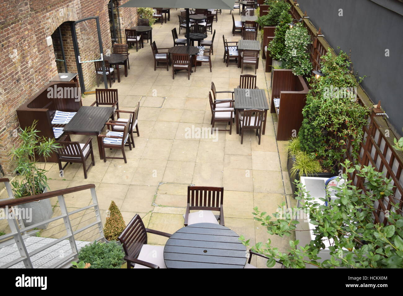 Overhead view of chairs and tables at an outdoor restaurant area Stock Photo