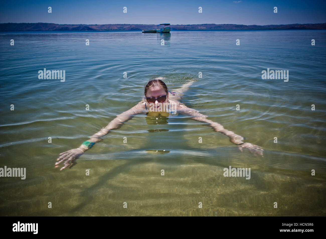 Woman swimming on a beach at Paapgayo Bay in Costa Rica - Stock Image