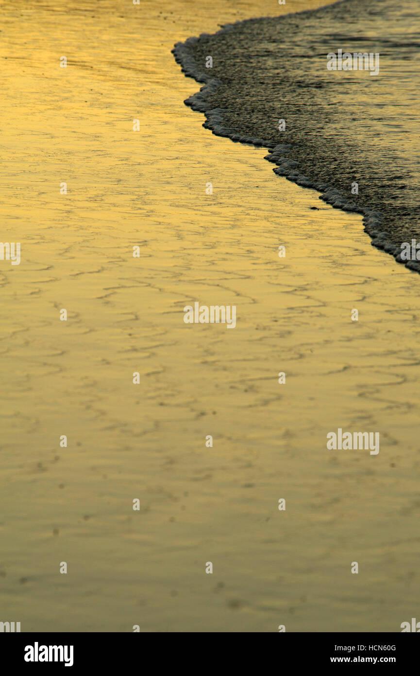 Black sand beach at Papagayo Bay - Stock Image