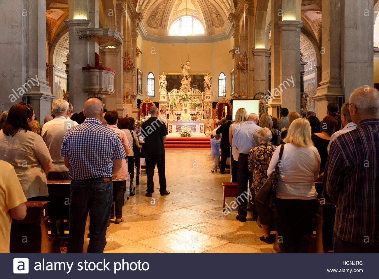 Rovinj: Service in the Church of St. Euphemia, Istria, Croatia - Stock Image
