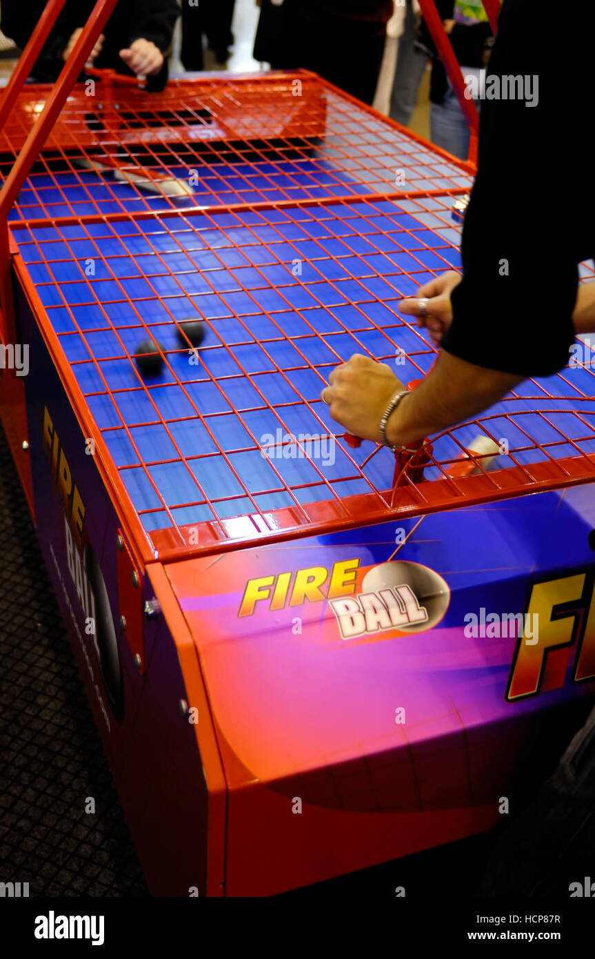 People playing Fire Ball table game Stock Photo