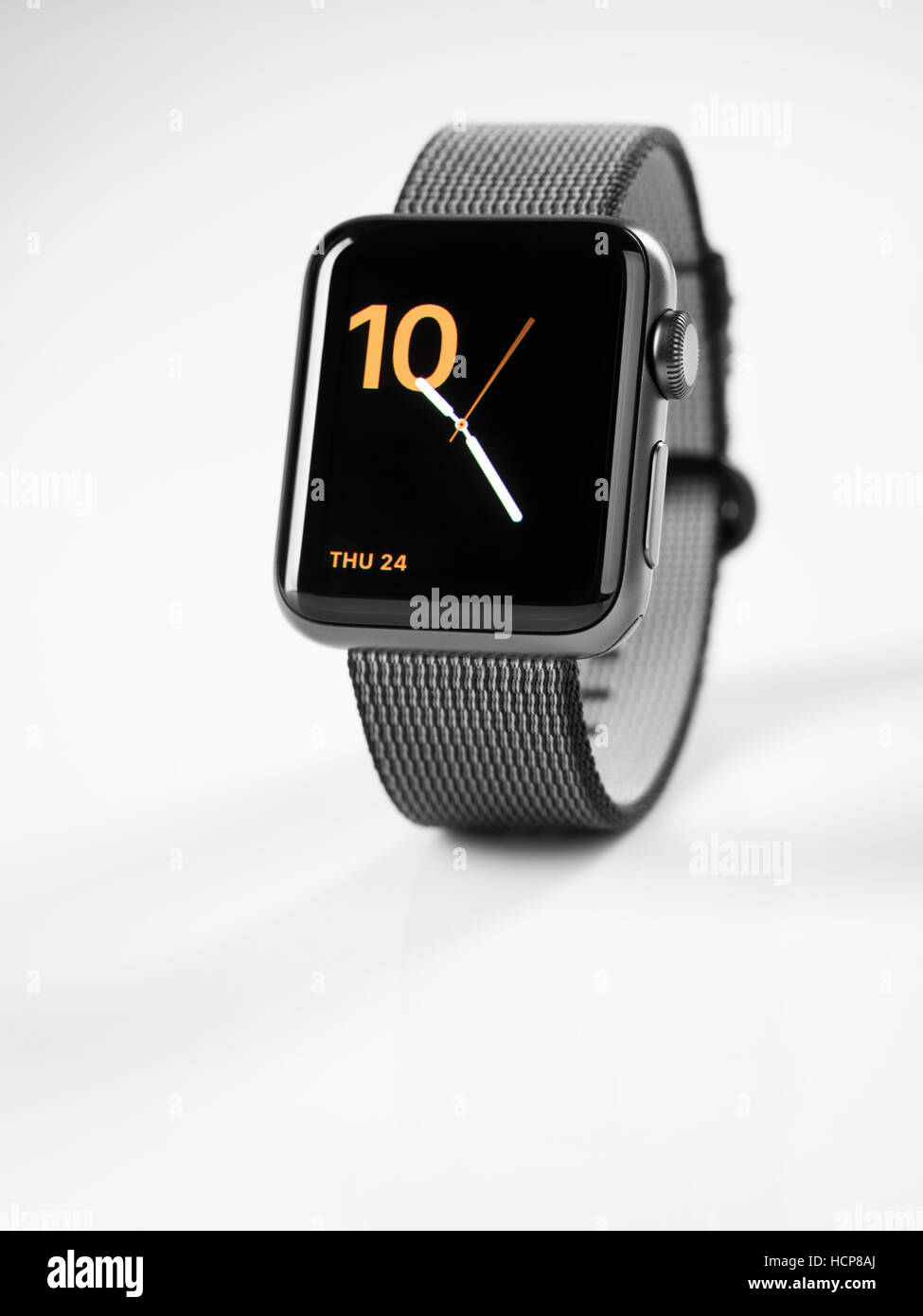 Apple Watch series 2 smartwatch with analog clock dial displayed, white background - Stock Image