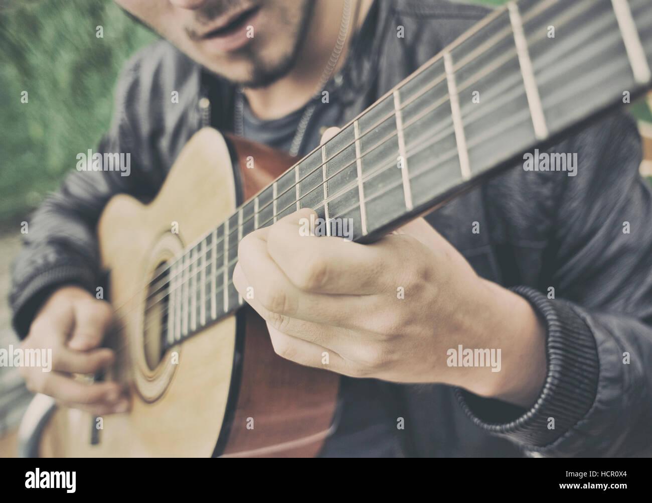 Man playing a guitar - Stock Image