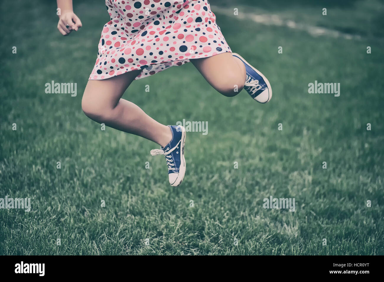 Girl running outdoors - Stock Image