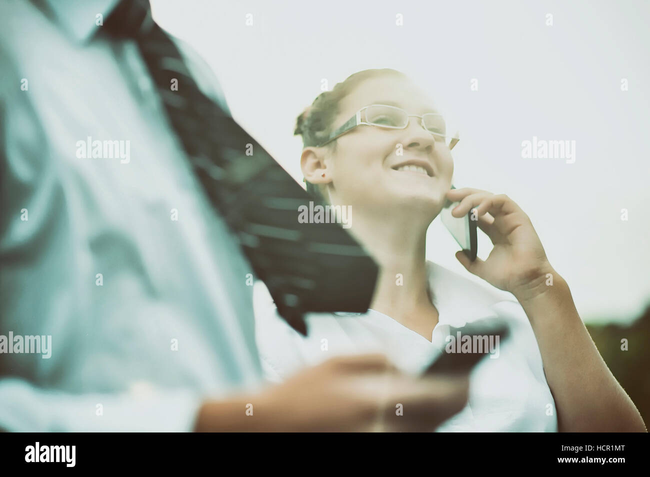 Man and girl talking on the phone - Stock Image