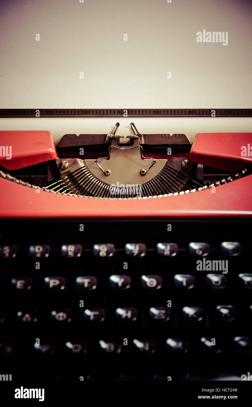 Close up of the letters on an old typewriter, with empty paper. - Stock Image
