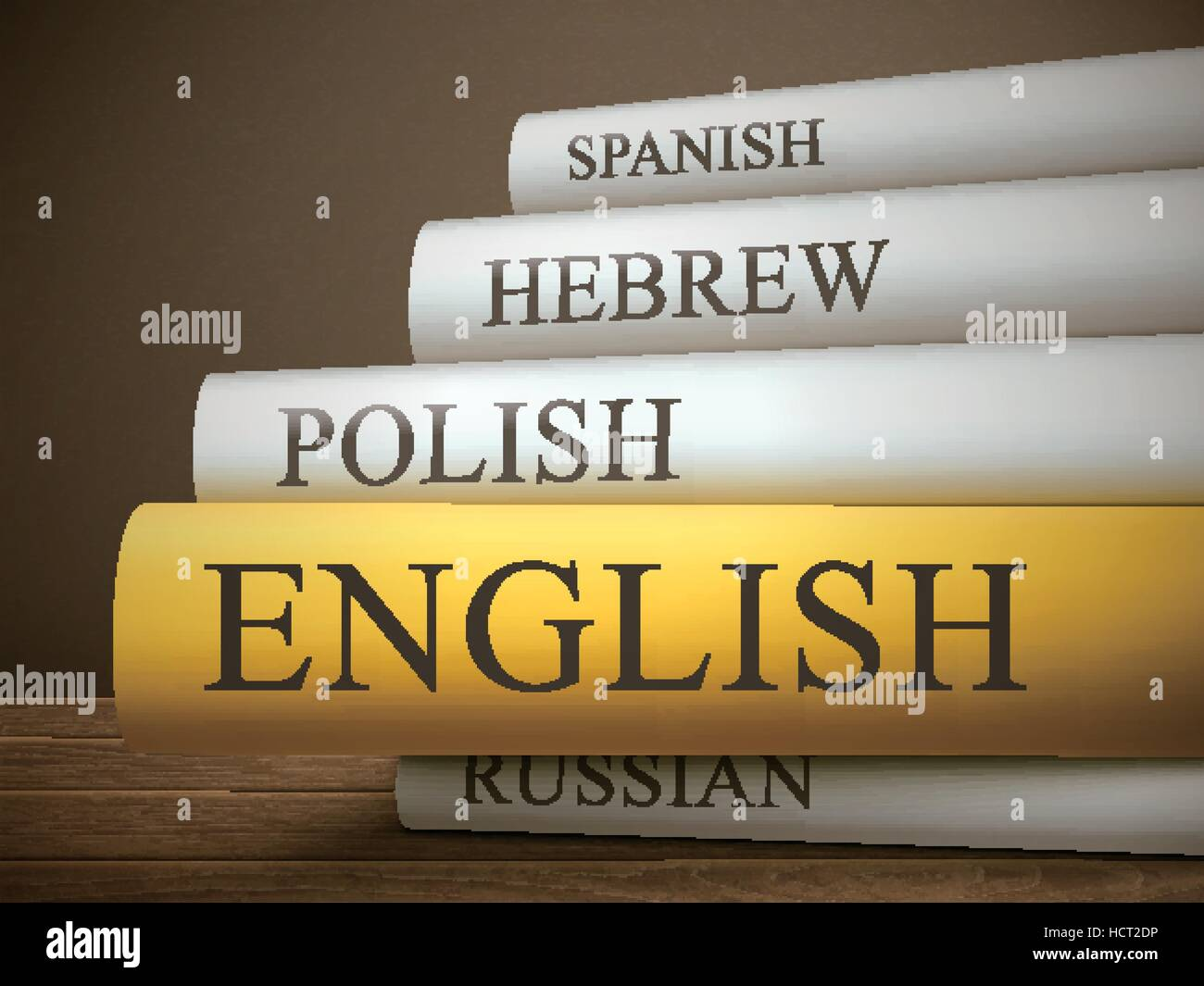 book title of english isolated on a wooden table over dark background - Stock Image