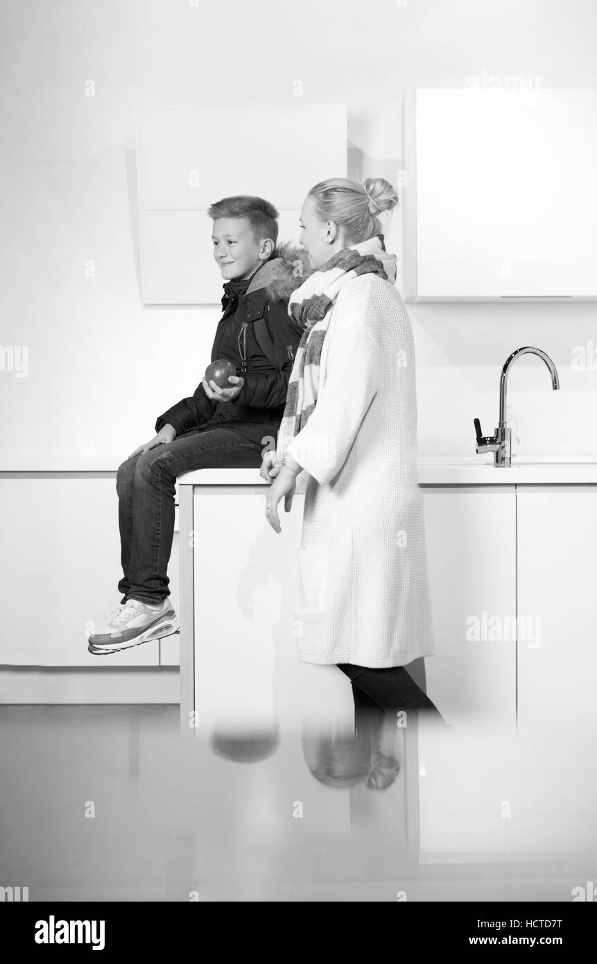 Mother Son Cooking In Kitchen Black and White Stock Photos & Images ...