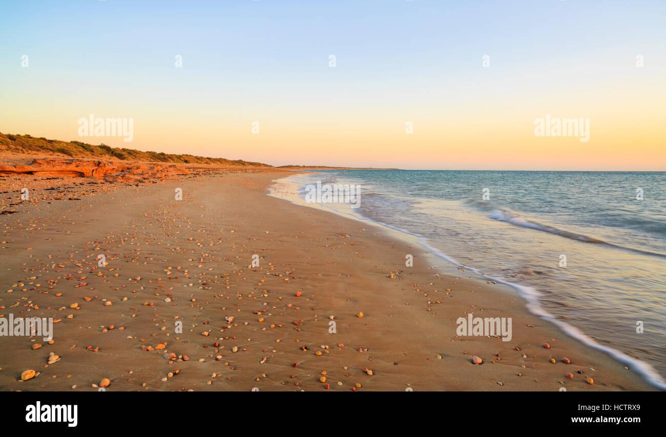 Pebble Beach at sunrise. Exmouth, Western Australia - Stock Image