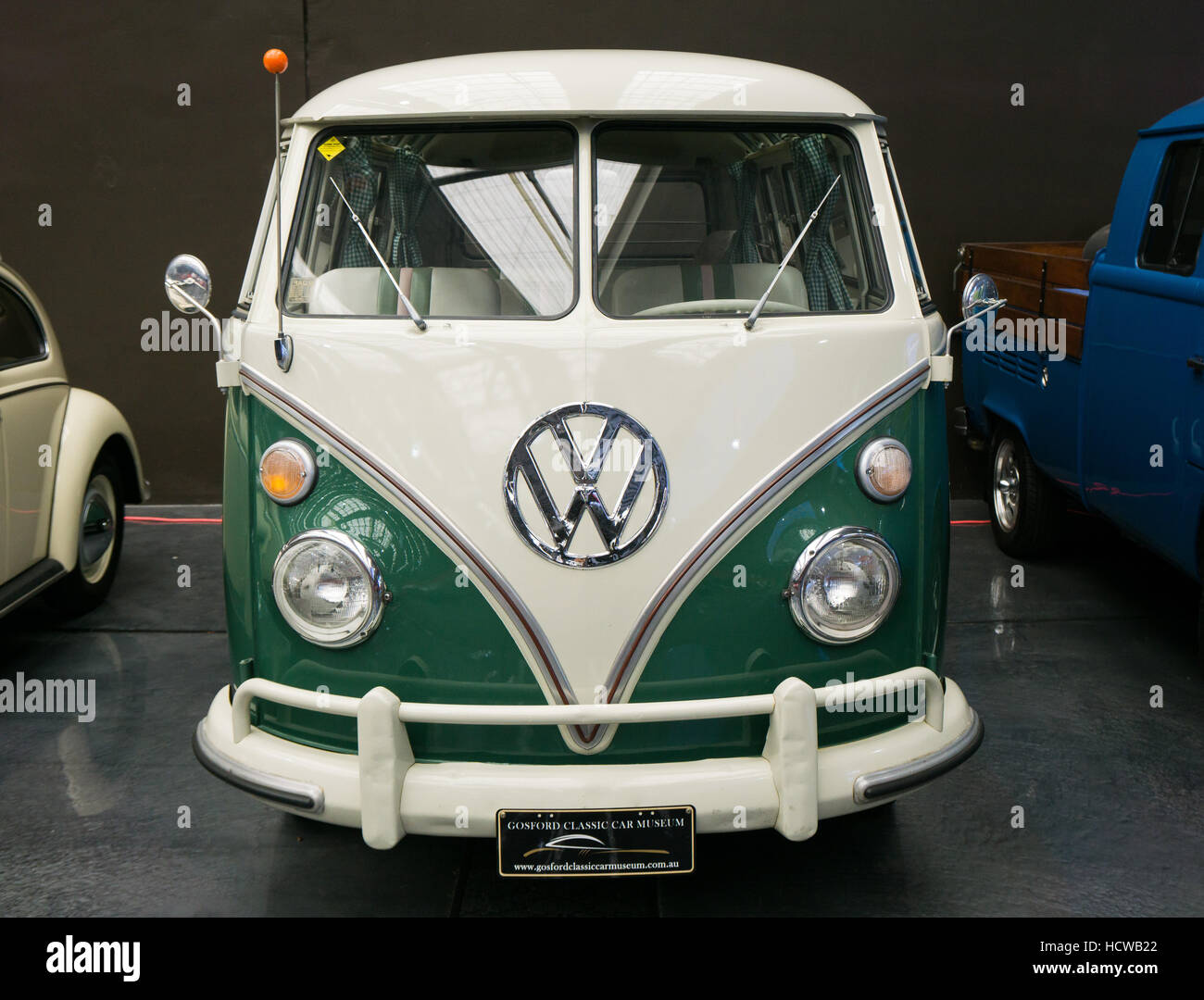 A white and green VW Bus from the 1960's - the so-call splitscreen type - Stock Image