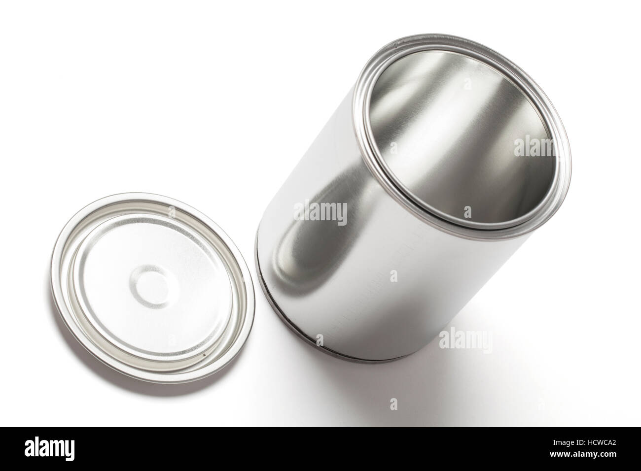 New blank and empty tin paint can with an open lid isolated on white background with clipping path. - Stock Image