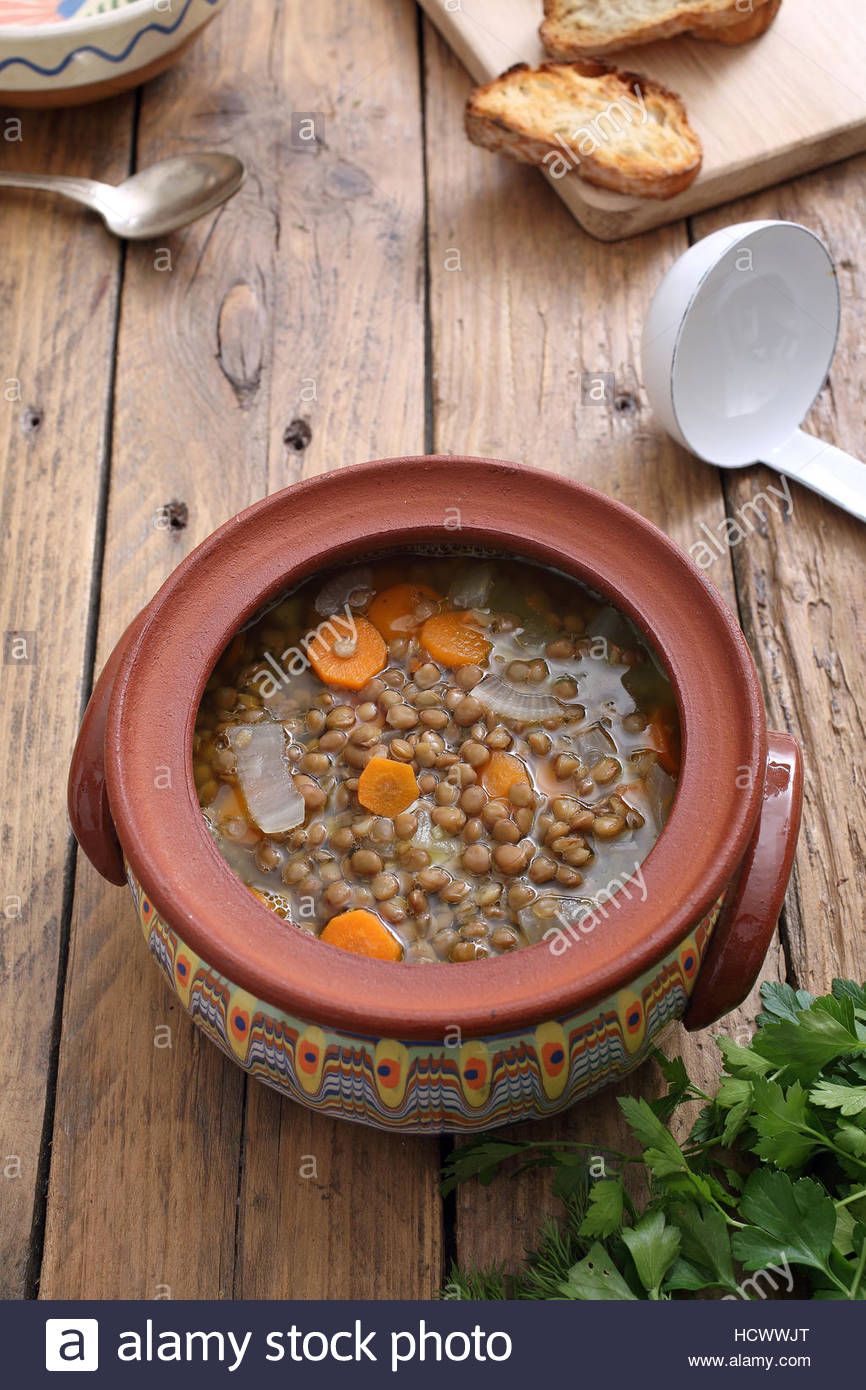 Lentil Soup in rustic ceramic jar Stock Photo