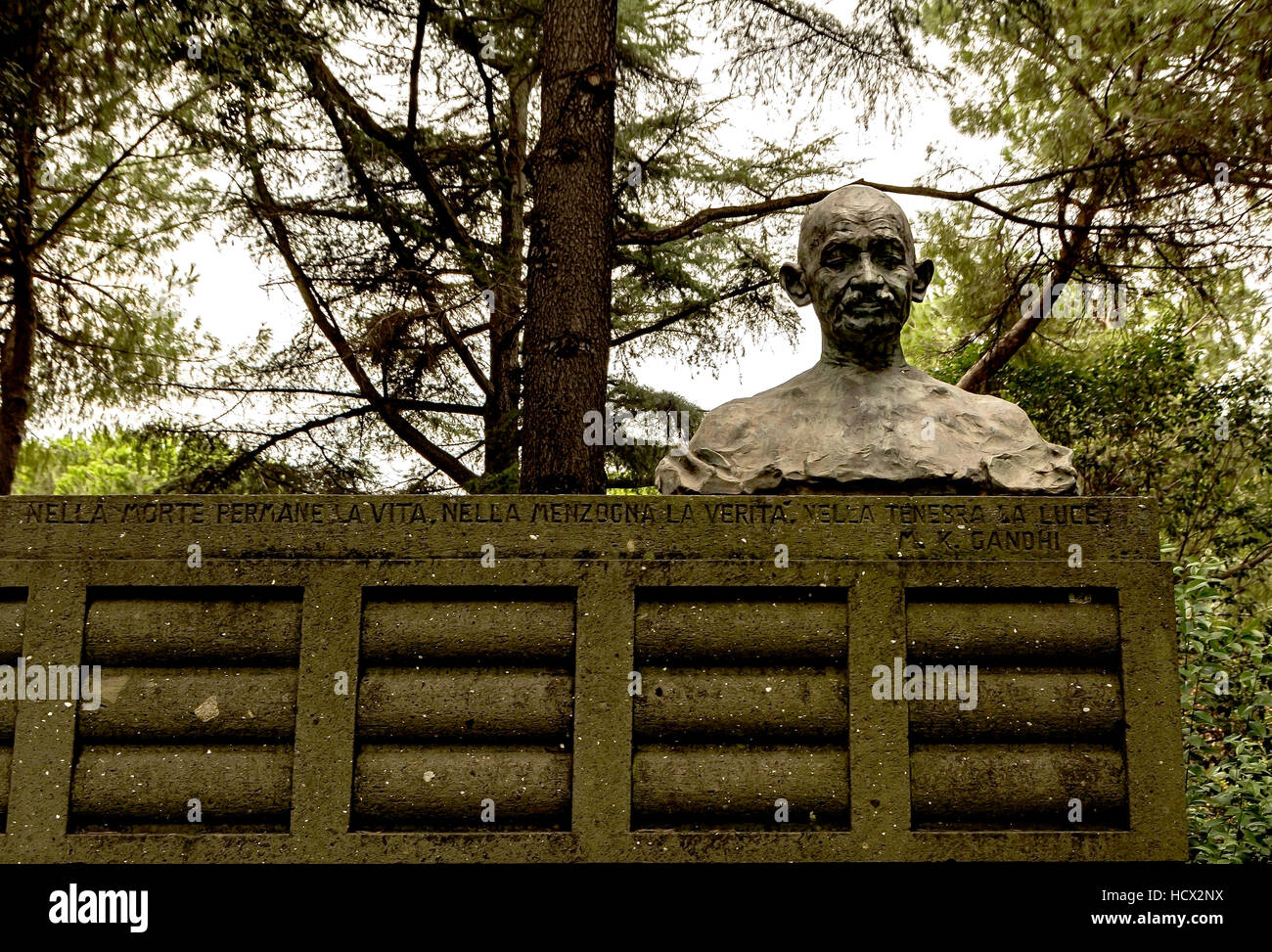 The Mahatma Gandhi Memorial statue in the shaded and peaceful  Piazza Gandhi in the EUR district of Rome. - Stock Image