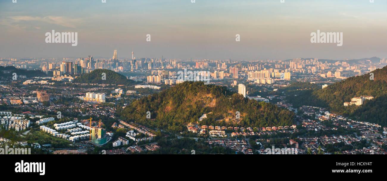 Kuala Lumpur skyline seen at sunrise from Bukit Tabur Mountain, Malaysia - Stock Image