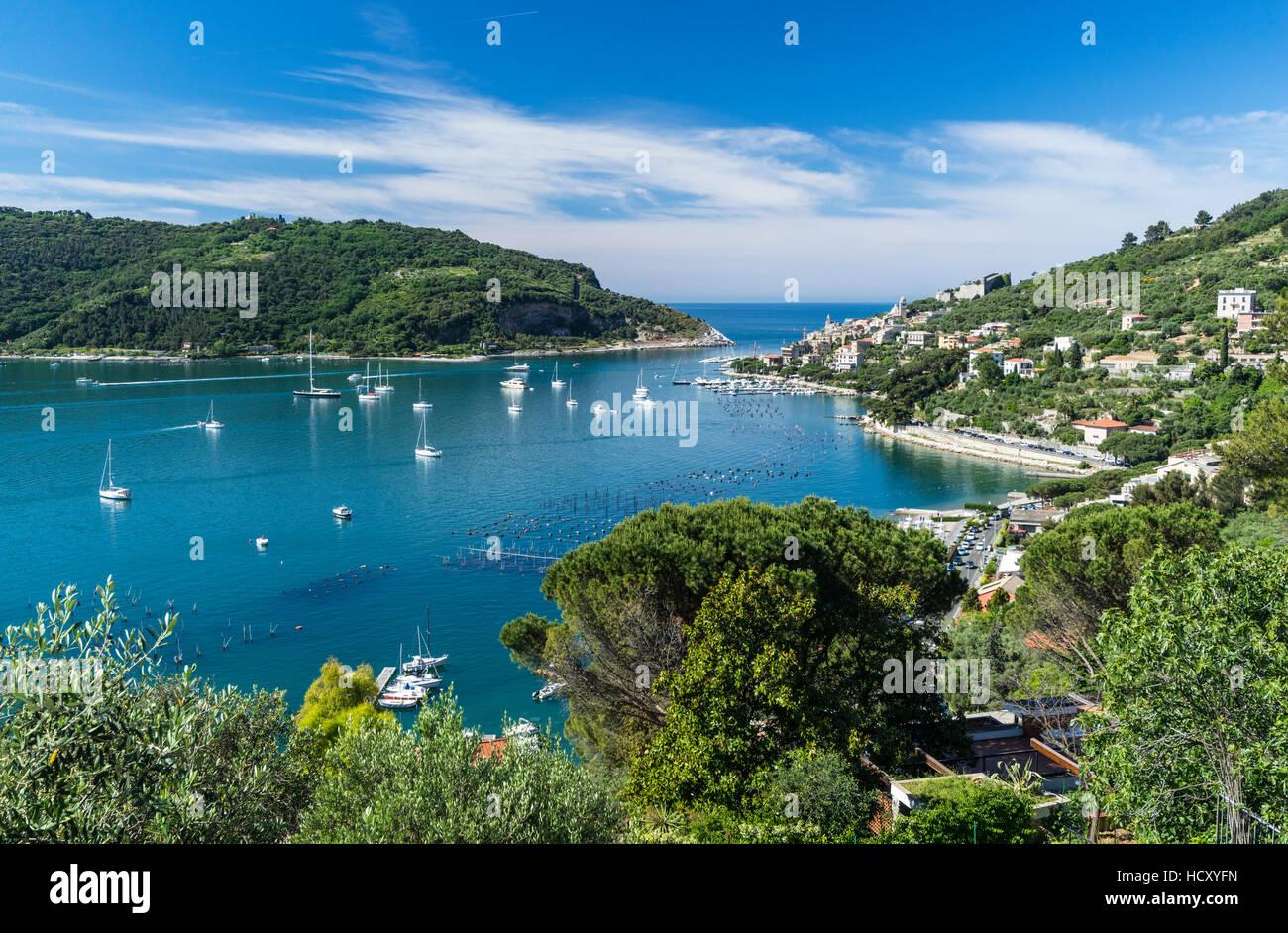 Green vegetation frames the turquoise sea of the Gulf of Poets surrounding Portovenere, La Spezia province, Liguria, - Stock Image