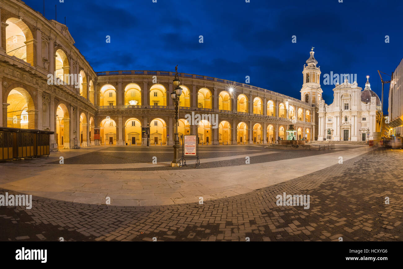 Night view of the ancient and holy Basilica of the Holy House framed by arcades, Loreto, Province of Ancona, Marche, - Stock Image