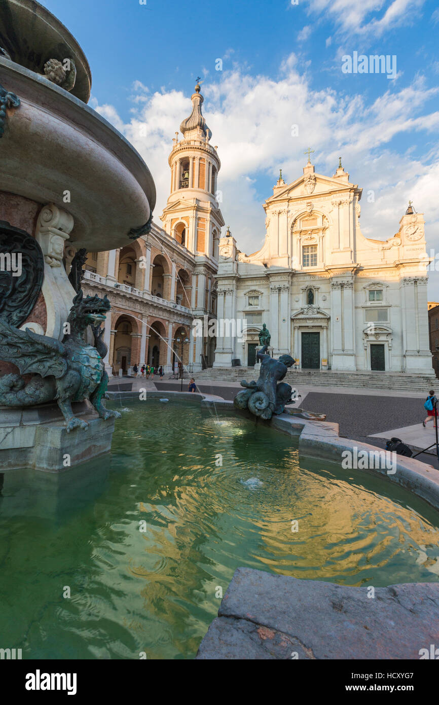View of the Basilica of the Holy House and fountain decorated with statues, Loreto, Province of Ancona, Marche, - Stock Image
