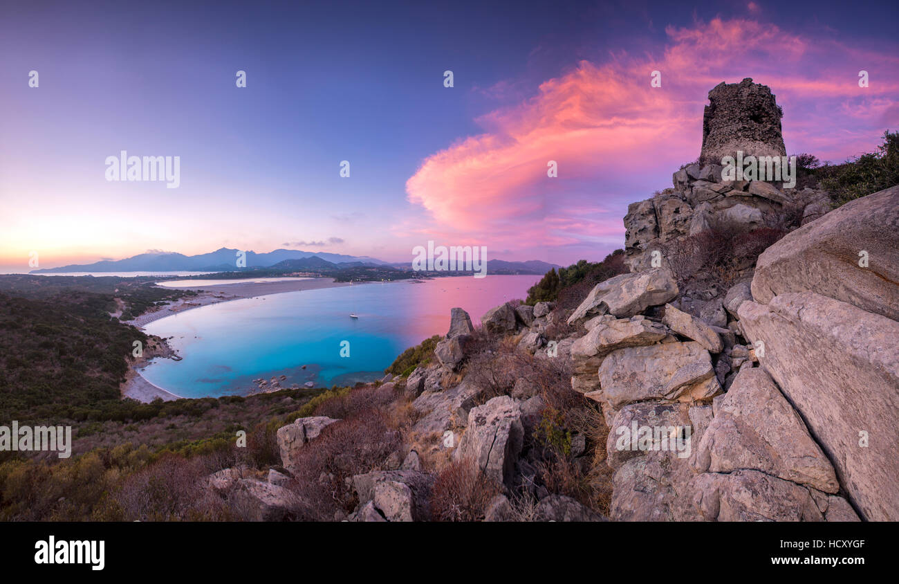 View of the bay and beaches from the stone tower at sunset, Porto Giunco, Villasimius, Province of Cagliari, Sardinia, - Stock Image