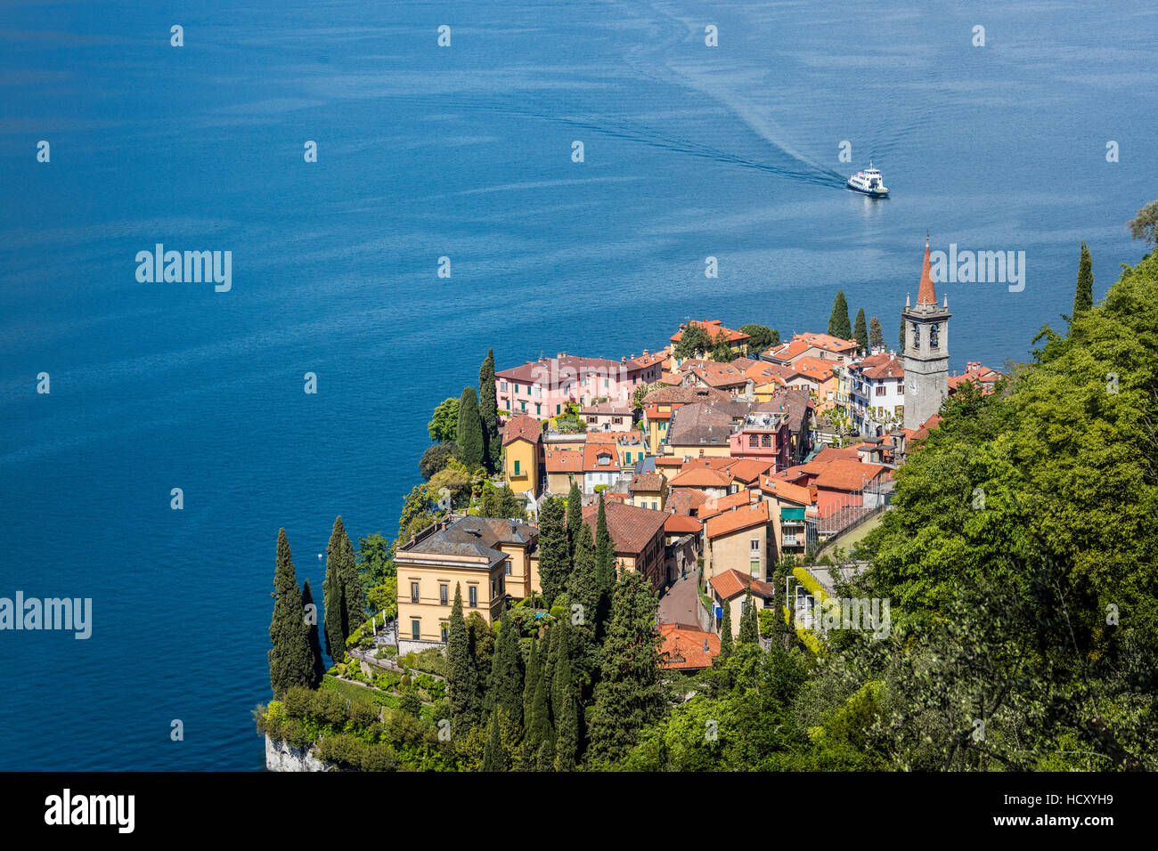 The typical village of Varenna surrounded by the blue water of Lake Como and gardens, Province of Lecco, Lombardy, - Stock Image
