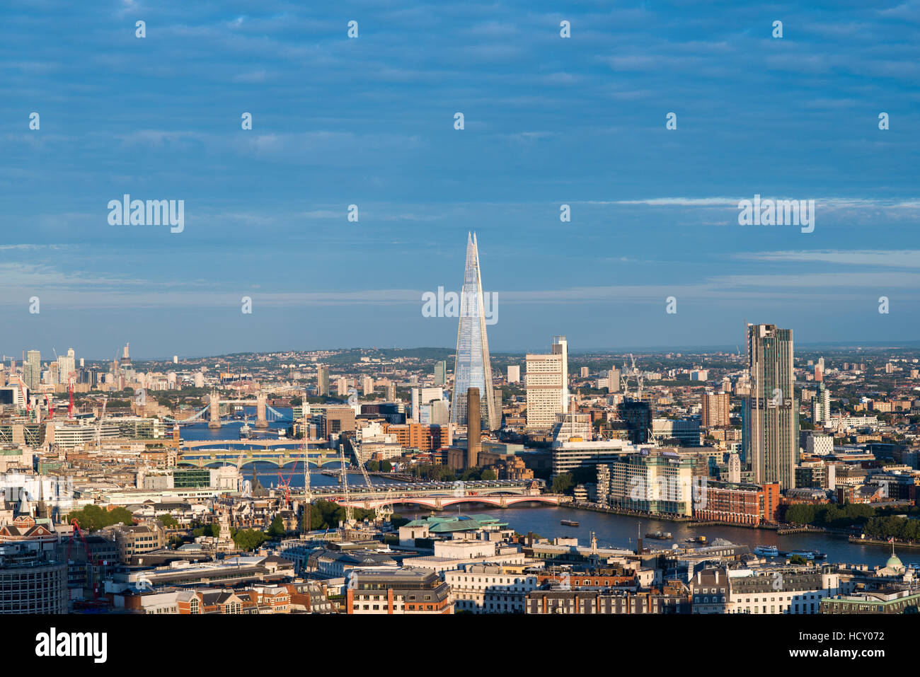 A view of London and the River Thames including The Shard, Tate Modern and Tower Bridge, London, UK - Stock Image