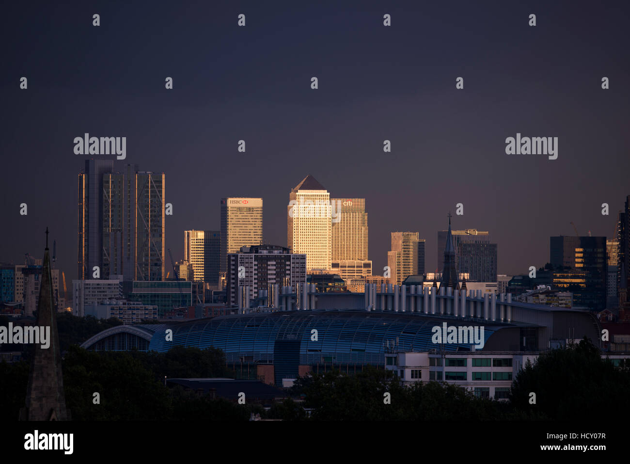 Canary Wharf, Docklands, at sunset from the top of Primrose Hill, London, UK - Stock Image