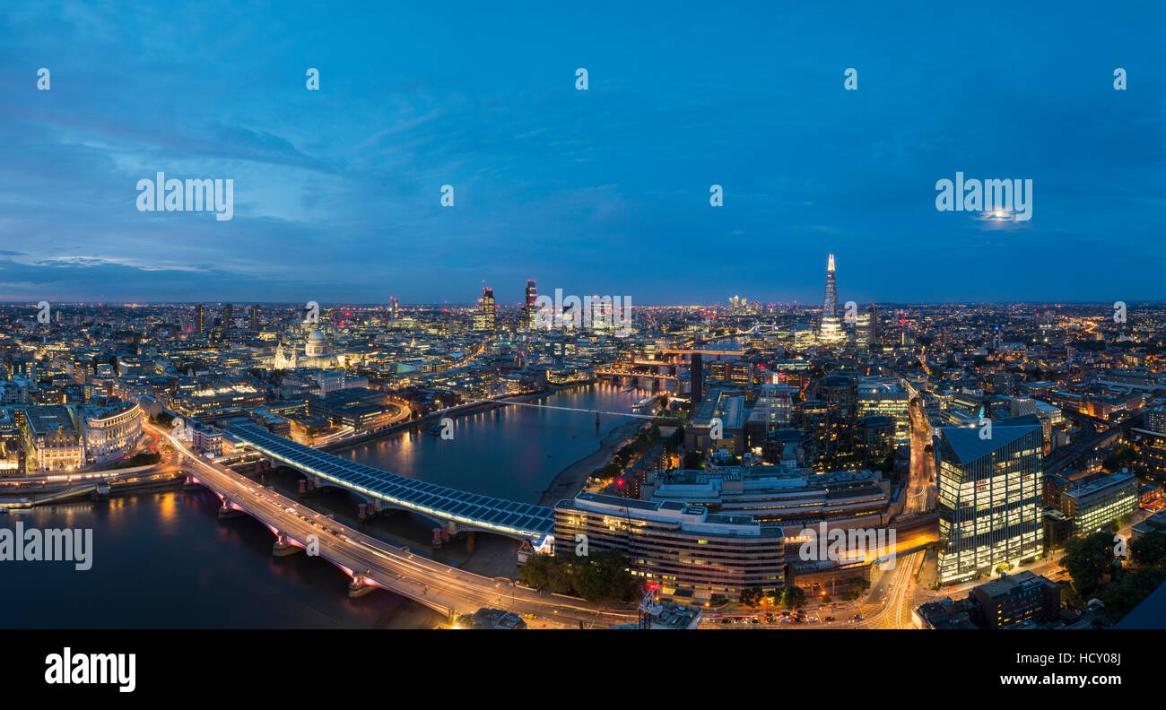 A night-time panoramic view of London and the River Thames showing The Shard and St. Paul's Cathedral, London, - Stock Image