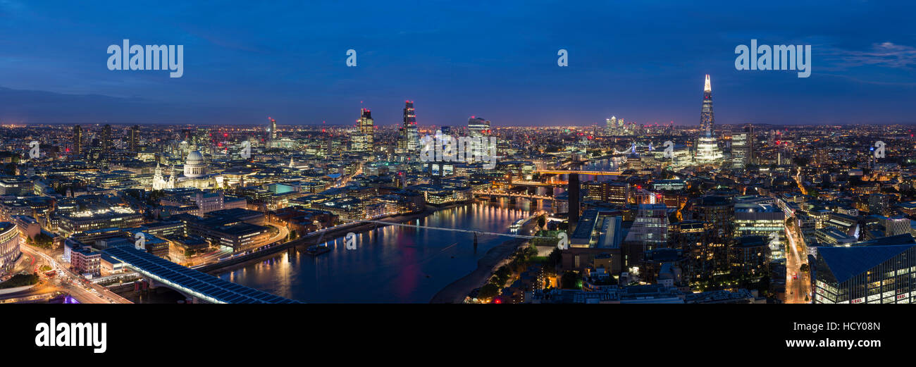A night-time panoramic view of London and the River Thames, showing The Shard and St. Paul's Cathedral, London, Stock Photo