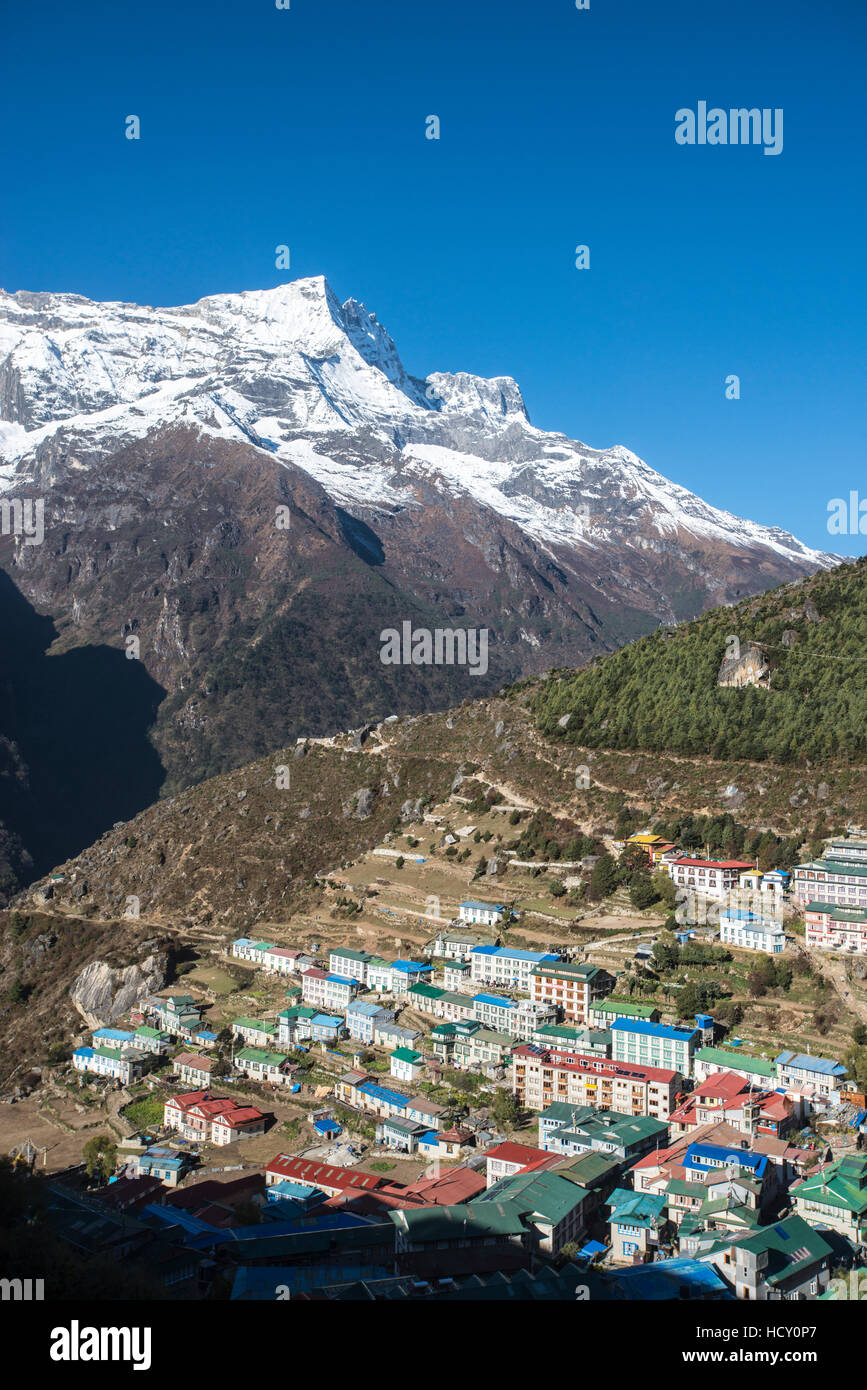 Namche Bazaar is the last town during the trek to Everest Base Camp, seen here with Kongde peak, Khumbu (Everest) - Stock Image