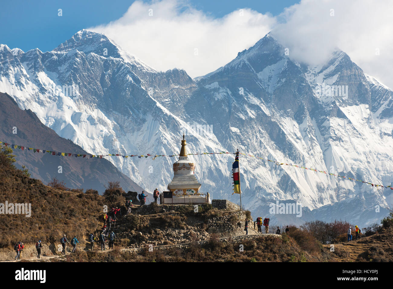 Hoards of trekkers make their way to Everest Base Camp, Mount Everest is the peak on the left, Khumbu Region, Nepal - Stock Image