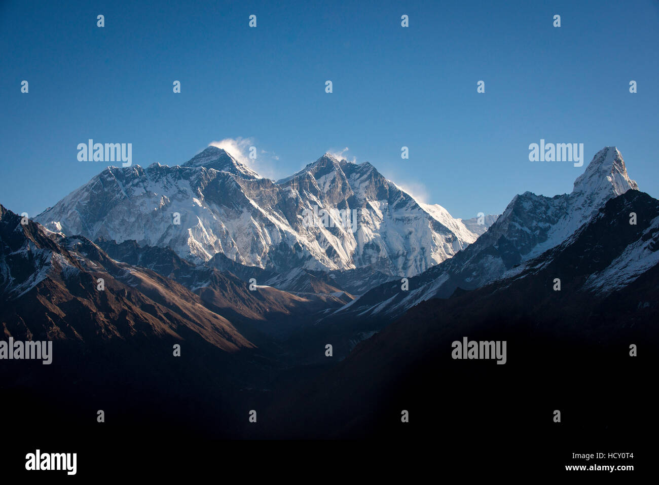 A view of Mount Everest, distant peak to the left behind the Nuptse-Lhotse ridge, from Kongde, Khumbu Region, Nepal - Stock Image