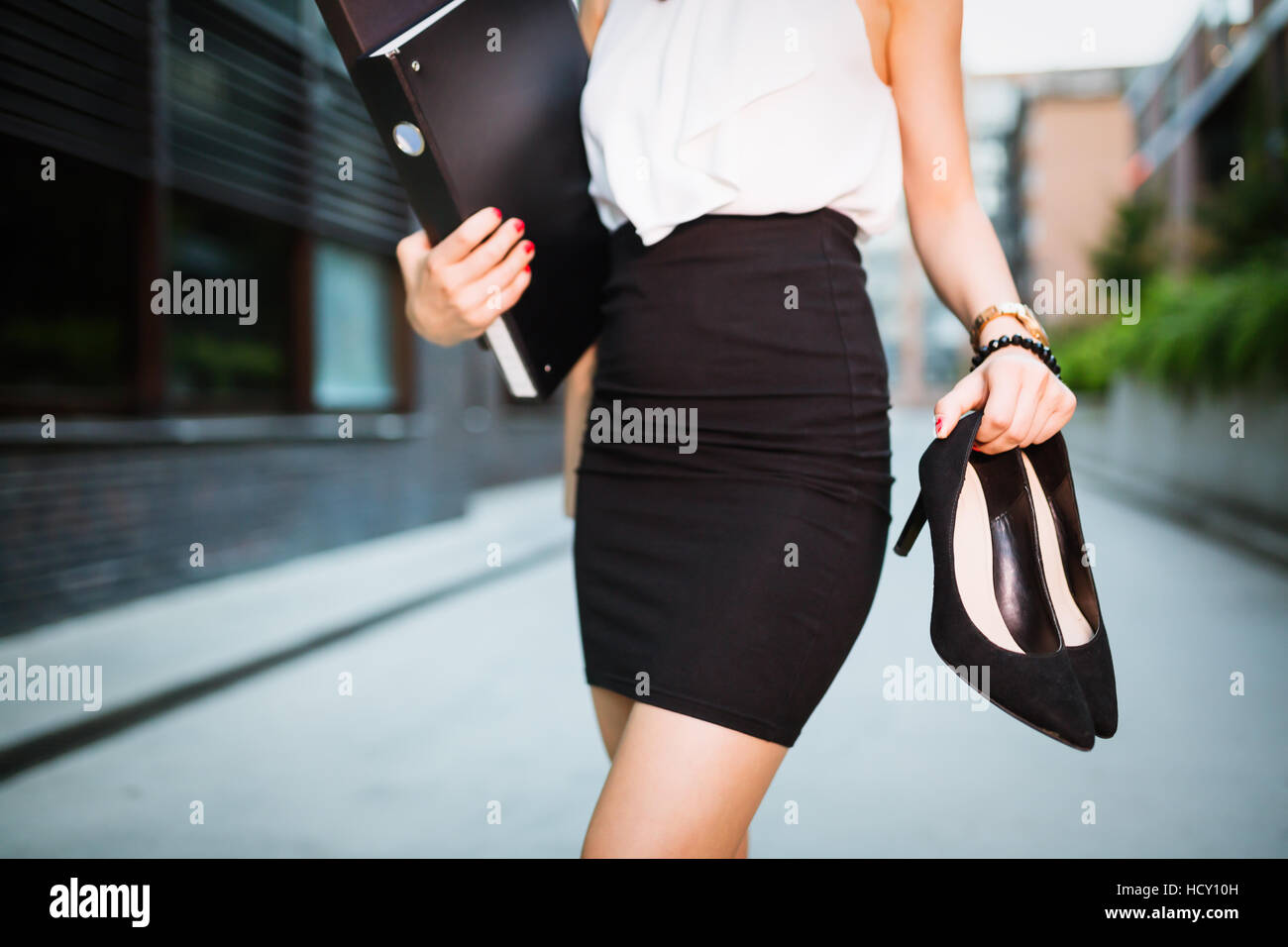 Woman finished working, no overtime  concept - Stock Image