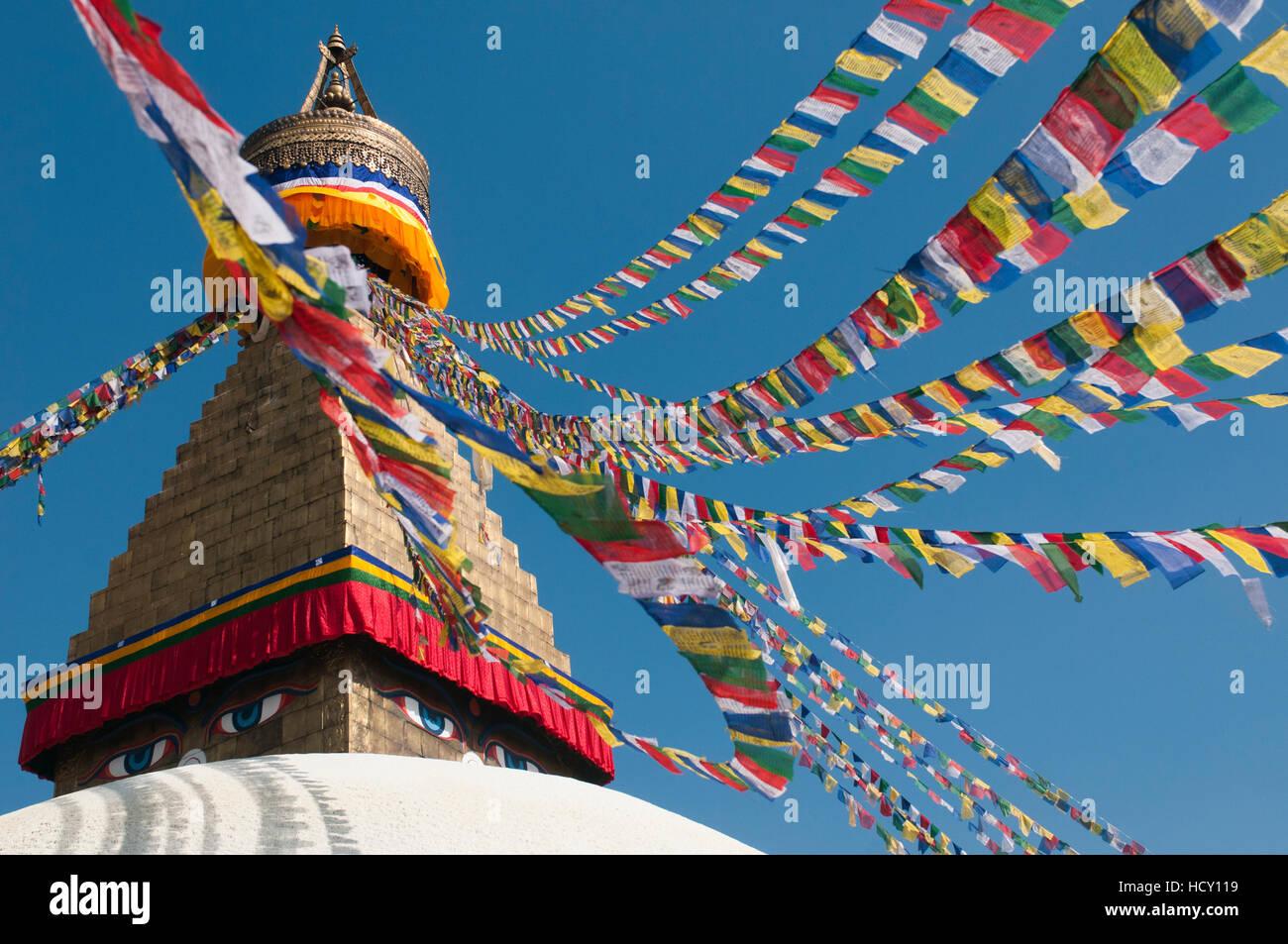 Bouddha (Boudhanath) (Bodnath) in Kathmandu is covered in colourful prayer flags, Kathmandu, Nepal - Stock Image